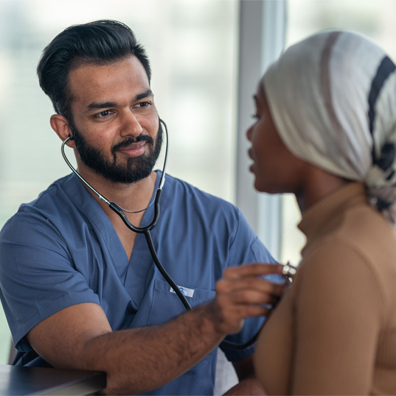 Male doctor meeting with female patient fighting cancer